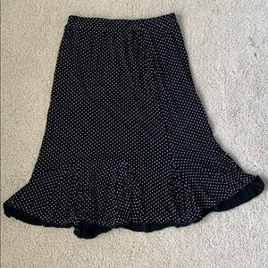 Black skirt with white polka dots.